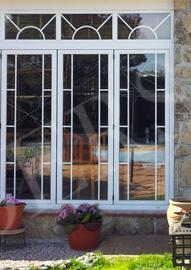 Cerramiento de terraza con ventanas en PVC